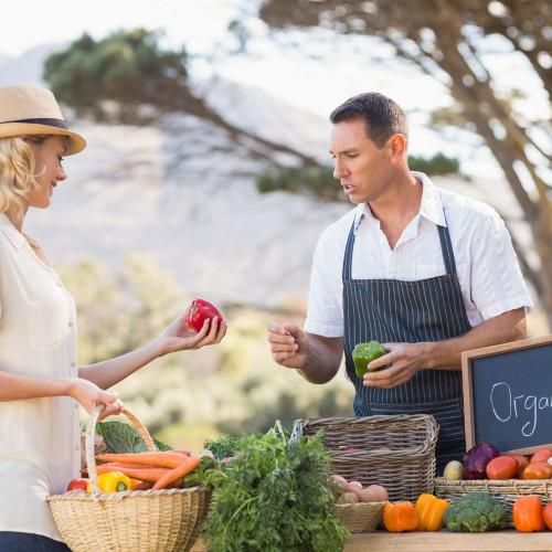 bigstock-farmer-discussing-with-a-custo-99132386.jpg